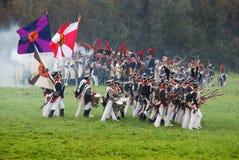 Borodino battle historical reenactment scene. BORODINO, MOSCOW REGION - SEPTEMBER 04, 2016: Reenactors dressed as Napoleonic war soldiers at Borodino battle Royalty Free Stock Photo
