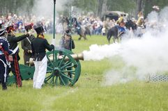 Borodino battle. Soldiers shutting. MOSCOW REGION, RUSSIA - MAY 27: Unidentified Soldiers shutting by cannon during 200 unniversary re-enactment of the Borodino stock image