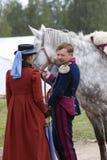 Borodino battle historical reenactment in Russia. Man and woman talking Royalty Free Stock Photo