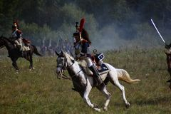 Reenactors ride horses at Borodino battle historical reenactment in Russia Royalty Free Stock Photography