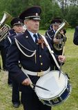 A drummer from a police brass band on the Borodino Field. Royalty Free Stock Photo