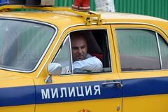 The officer of the road patrol service driving the GAZ-24 `Volga` police car. BORODINO, RUSSIA - JUNE 20, 2015: The officer of the road patrol service driving Stock Photo