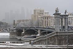 Borodinsky bridge in Moscow at snowfall royalty free stock photos