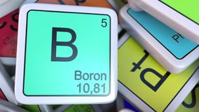 Boron block on the pile of periodic table of the chemical elements blocks. Chemistry related 3D rendering. Boron tag on the pile of periodic table of the Royalty Free Stock Photos