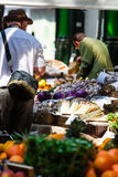 Borough Market. A man picks vegetables from a stall at the Borough market in central London royalty free stock photo