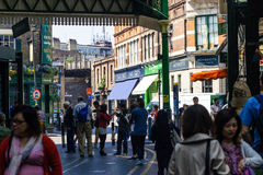 Borough Market. Many people walk the streets through the Borough market in central London Royalty Free Stock Images