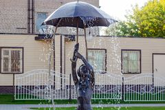 BOROVSK, RUSSIA - SEP. 2017: Fountain with a sculpture of a girl with an umbrella. `Let it shine` in the square of Borovsk royalty free stock images