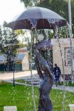BOROVSK, RUSSIA - SEP. 2017: Fountain with a sculpture of a girl with an umbrella. `Let it shine` in the square of Borovsk royalty free stock photos