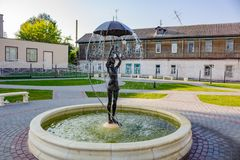 BOROVSK, RUSSIA - SEP. 2017: Fountain with a sculpture of a girl with an umbrella. `Let it shine` in the square of Borovsk stock photo