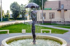 BOROVSK, RUSSIA - SEP. 2017: Fountain with a sculpture of a girl with an umbrella. `Let it shine` in the square of Borovsk royalty free stock image