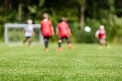 Borrão do futebol das crianças Fotografia de Stock Royalty Free