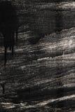 Borrões da pintura preta em um fundo textured metálico, proteção anticorrosiva, decorando com as faíscas do metal imagem de stock royalty free
