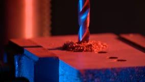 Borra av metall på etthjälpmedel Arkivfoto