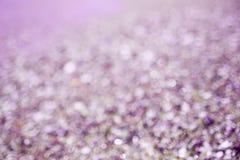 Borre os círculos violetas do bokeh do fundo roxo abstrato foto de stock royalty free