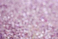Borre os círculos violetas do bokeh do fundo roxo abstrato fotos de stock royalty free