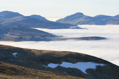 Borrowdale Fells from Helvellyn. High on the Lakeland tops looking across a temperature inversion that blankets the dales and valleys below. In the distance are Royalty Free Stock Image