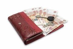 Borsa con la fattura e la chiave di soldi Immagine Stock