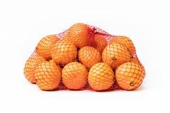 Borsa dei mandarini su fondo bianco fotografie stock