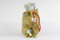 Borsa dei soldi su un fondo bianco Fotografia Stock