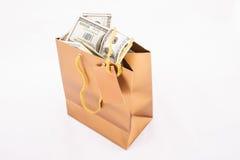 Borsa del regalo dell'oro con i dollari Fotografia Stock Libera da Diritti