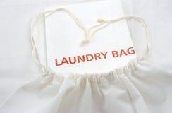 Borsa della lavanderia del tessuto dell'ospite Fotografie Stock