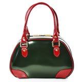 Borsa di cuoio lucida verde con le maniglie di rosso su un fondo bianco Fotografia Stock
