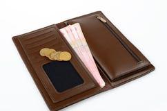 Borsa e soldi Fotografie Stock