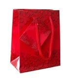 Borsa rossa decorativa del regalo con gli ornamenti del fiore Fotografia Stock Libera da Diritti