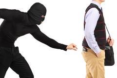 Borsaiolo che prova a rubare un raccoglitore Fotografia Stock Libera da Diritti