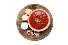 Borsch with bacon and pampushkas on a wooden board isolated on a white background royalty free stock photos