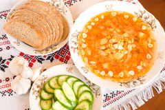 Borsch, black bread and sliced cucumber Stock Image