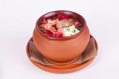 Borsch borscht, Clay pot isolated on a white Royalty Free Stock Images