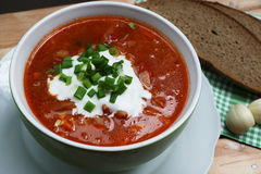 Borsch, bread and garlic on the table. National Ukrainian dish - borsch, soup with cabbage Stock Photography