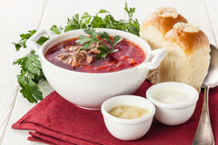 Borsch with bread pampushki Royalty Free Stock Photography