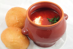 Borsch in the pot. With two breads stock image