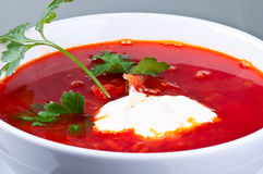 Borsch or red beet soup. Homemade red-beet soup with parsley and sour cream Royalty Free Stock Image