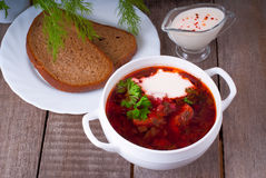 Borsch, soup from a beet, meat and cabbage with tomato sauce. Ukrainian and russian national cuisine royalty free stock photo