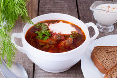 Borsch, soup from a beet, meat and cabbage with tomato sauce. Ukrainian and russian national cuisine stock photo
