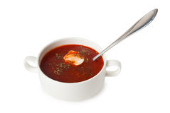 Borsch in soup bowl and spoon. Isolated on white background stock photography