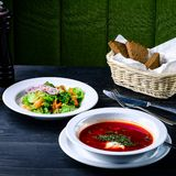 Borsch soup in a cafe, lunch menu. On a dark table royalty free stock image