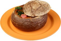 Borsch soup is poured in a dish as bread. Traditional Ukrainian meal stock image