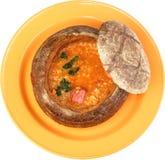 Borsch soup is poured in a dish as bread Stock Photos