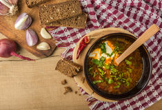Borsch-soup with sour cream and bread. Top view. Tasty and nutritious borsch-soup with meat, potatoes, cabbage, tomatoes, beans, sour cream, parsley, onion stock image