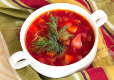 Borsch in white bowl . Red beetroot traditional soup. Stock Photos