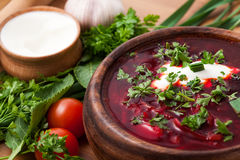 Borsch in a wooden plate Stock Images