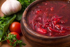 Borsch in a wooden plate Stock Image