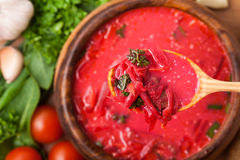 Borsch in a wooden plate Royalty Free Stock Photos