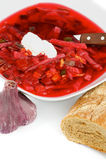 Borscht. Delicious Traditional Beet Soup Borscht Arranging with Garlic and Brown Bread closeup on white background stock images