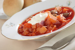 Borscht with sour cream Stock Images