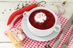 Borscht with sour cream and hot pepper in a ceramic bowl Stock Photography
